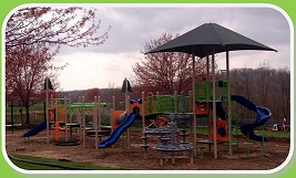 A large playground complex at Pine Community Park.